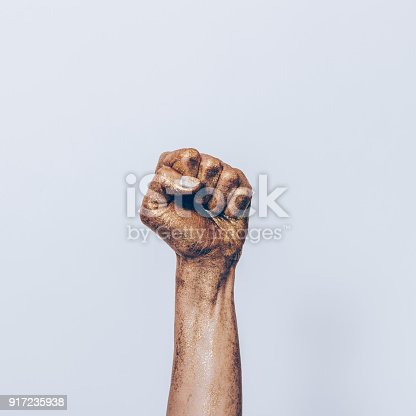 istock Female fist of golden color 917235938