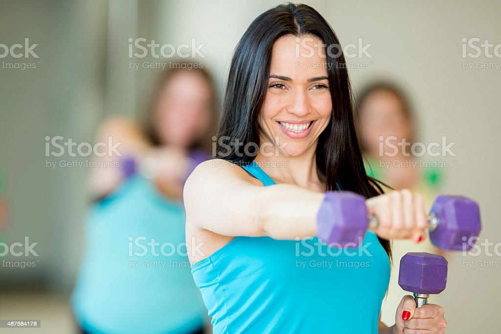 Female Fitness Class with Free Weights stock photo