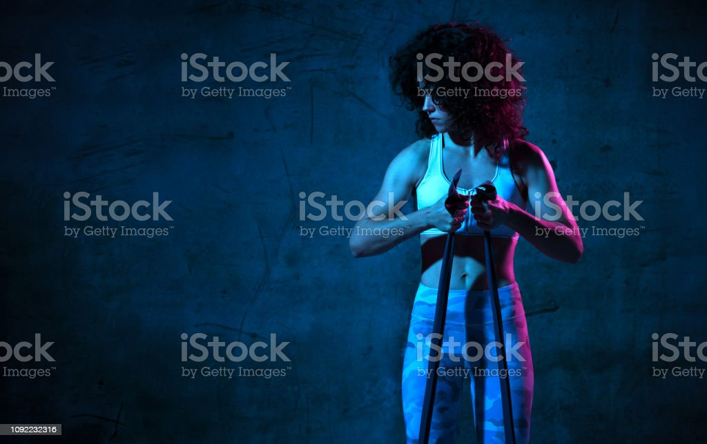 Woman exercising doing postnatal workout. Female fitness instructor...