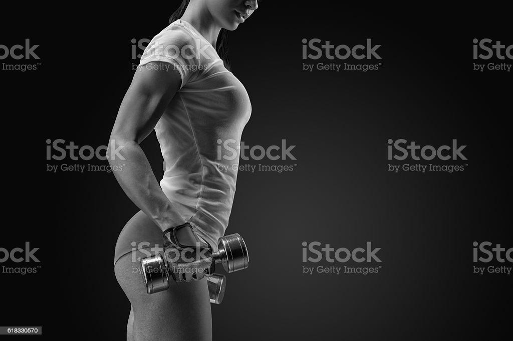 Female fitness model exercising with dumbbell stock photo