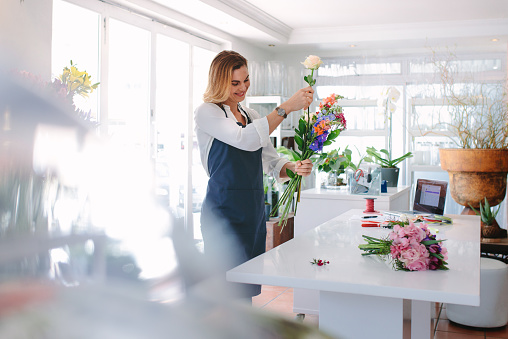 Female florist creating order
