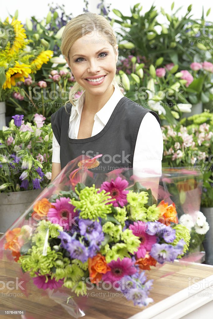 Female Florist Making Bouquet In Shop royalty-free stock photo