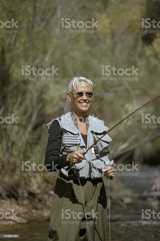 Female Fly Fishing royalty-free stock photo