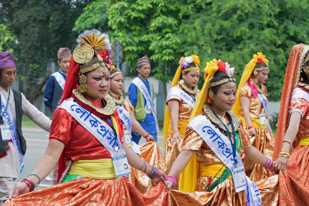 Female folk dancers marching past stock photo