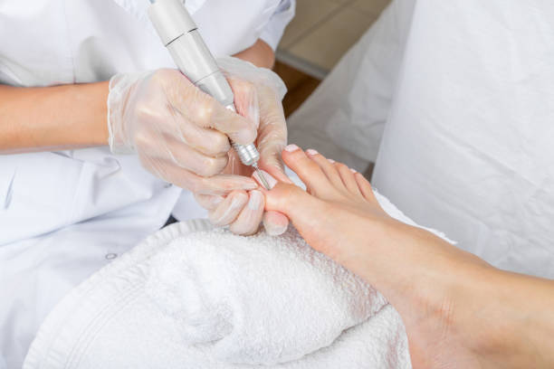 female foot in process of pedicure procedure - podiatry stock pictures, royalty-free photos & images
