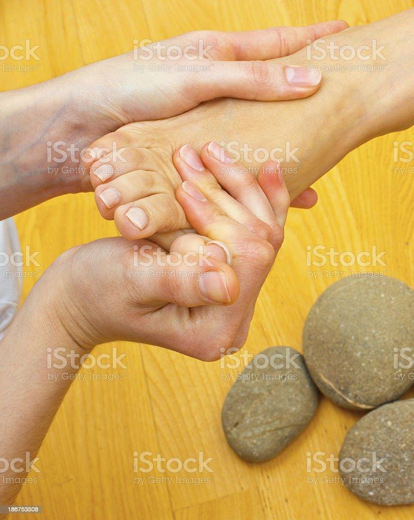 female foot on massage spa treatment royalty-free stock photo
