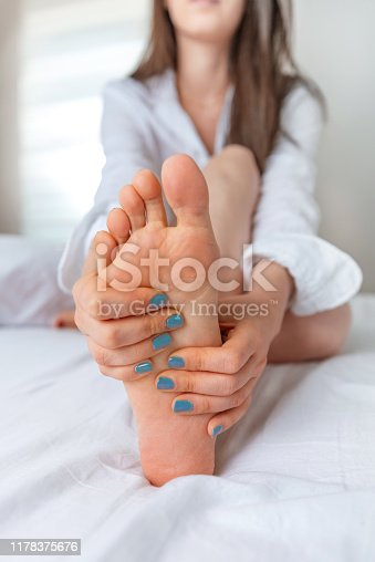901404510istockphoto Female foot pain 1178375676