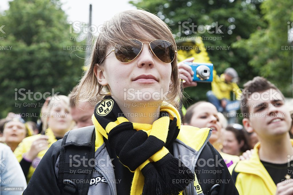 female football fan celebrating royalty-free stock photo