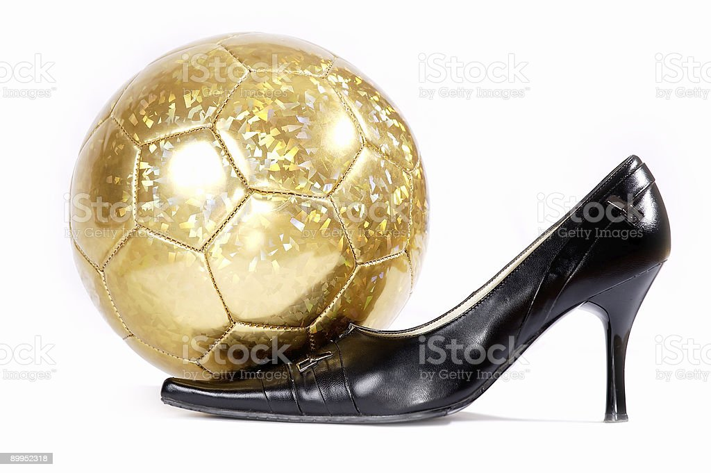 Female footwear and football on a white background royalty-free stock photo