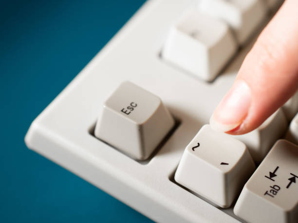 Female forefinger pushes apostrophe button. Close-up Female forefinger pushes apostrophe button. Close-up view apostrophe stock pictures, royalty-free photos & images
