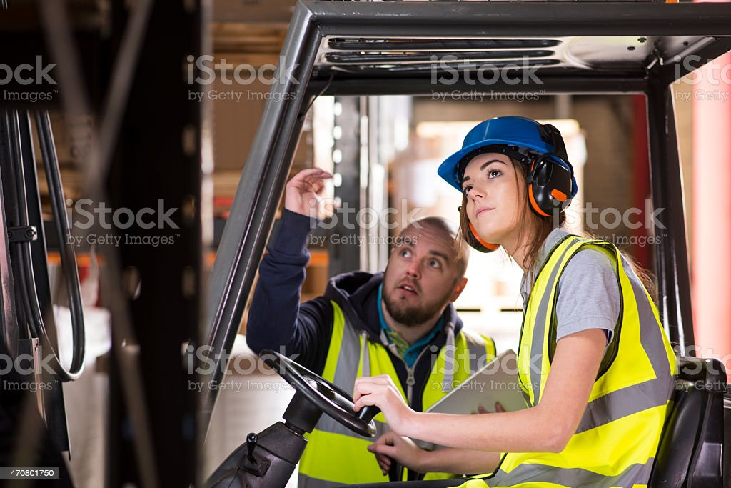 female forklift driver training stock photo