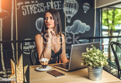 istock female freelancer sit at the table with net-book 534608004
