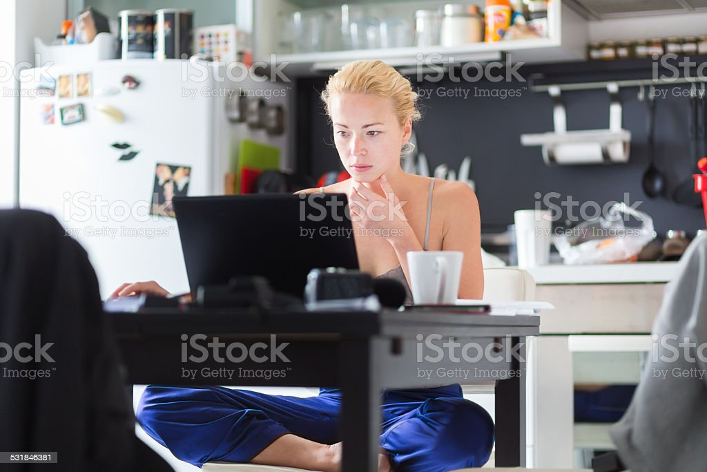 Female freelancer working from home. stock photo