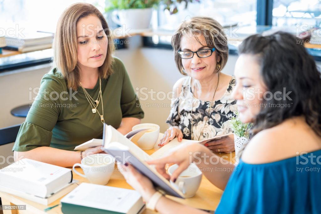 Female friends at book club stock photo