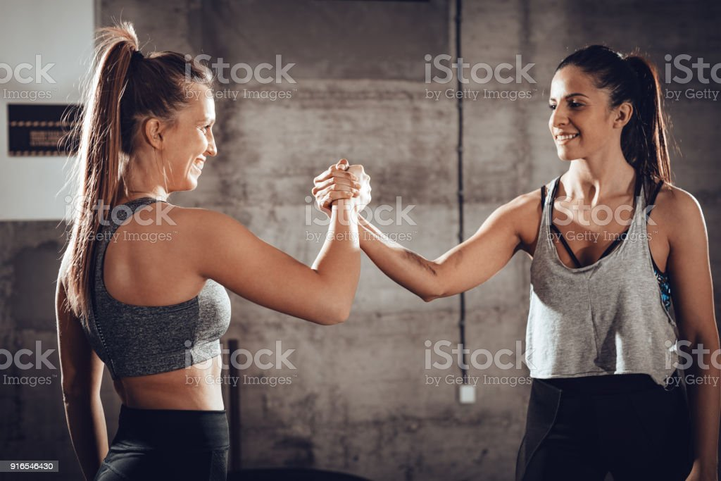 Female Friends At The Cross Training stock photo