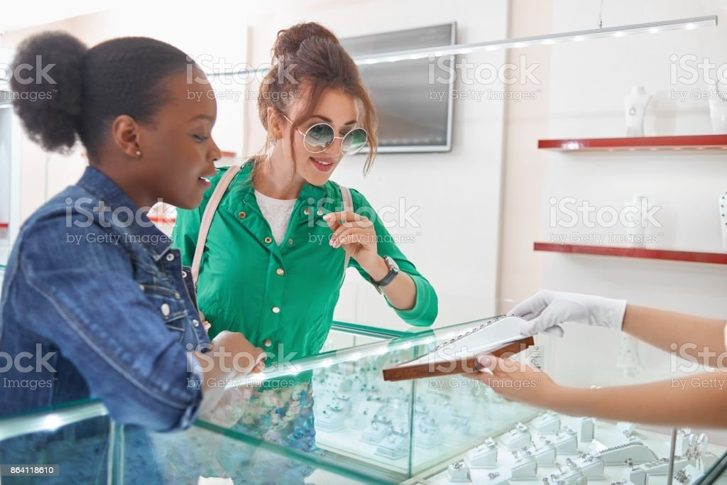 Female friends at the jewelry store royalty-free stock photo