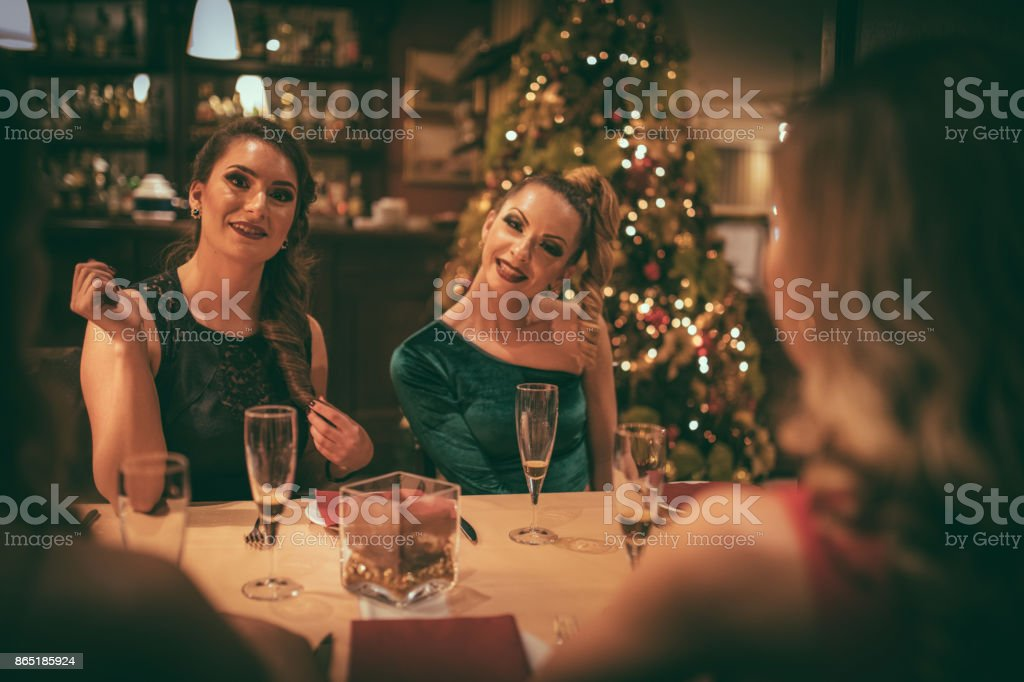 Female friends at the restaurant stock photo