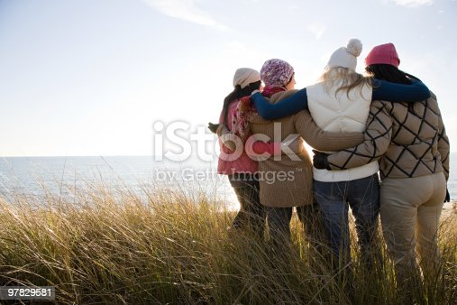 istock Female friends by the sea 97829581