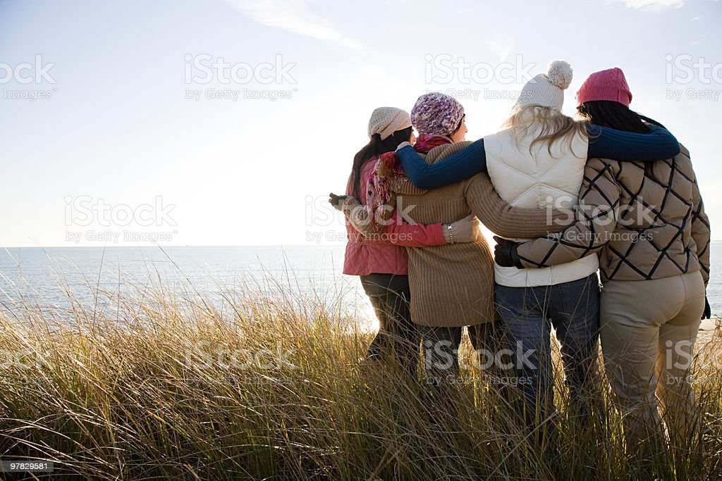 Female friends by the sea stock photo