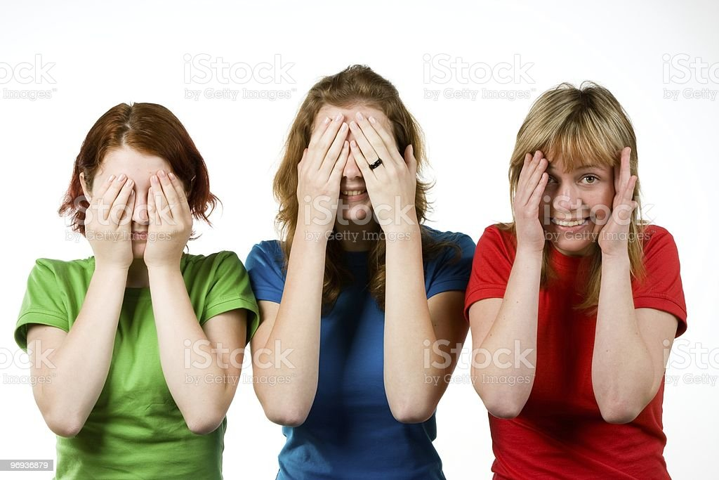 Female friends covering eyes royalty-free stock photo