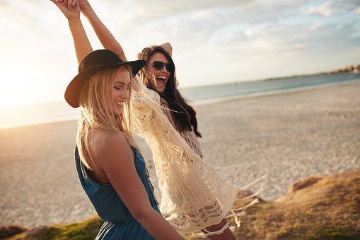 Female friends enjoying a day at sea coast