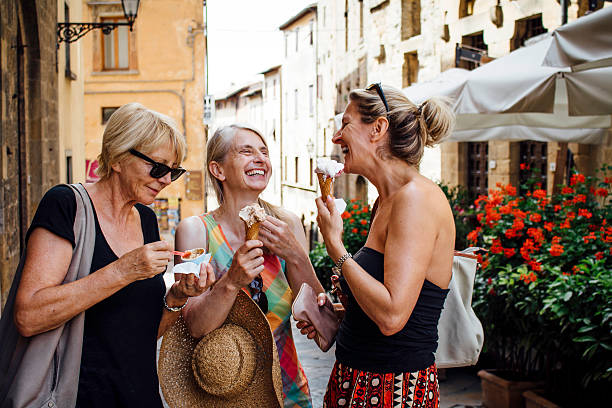 female friends enjoying italian ice-cream - tourism stock pictures, royalty-free photos & images