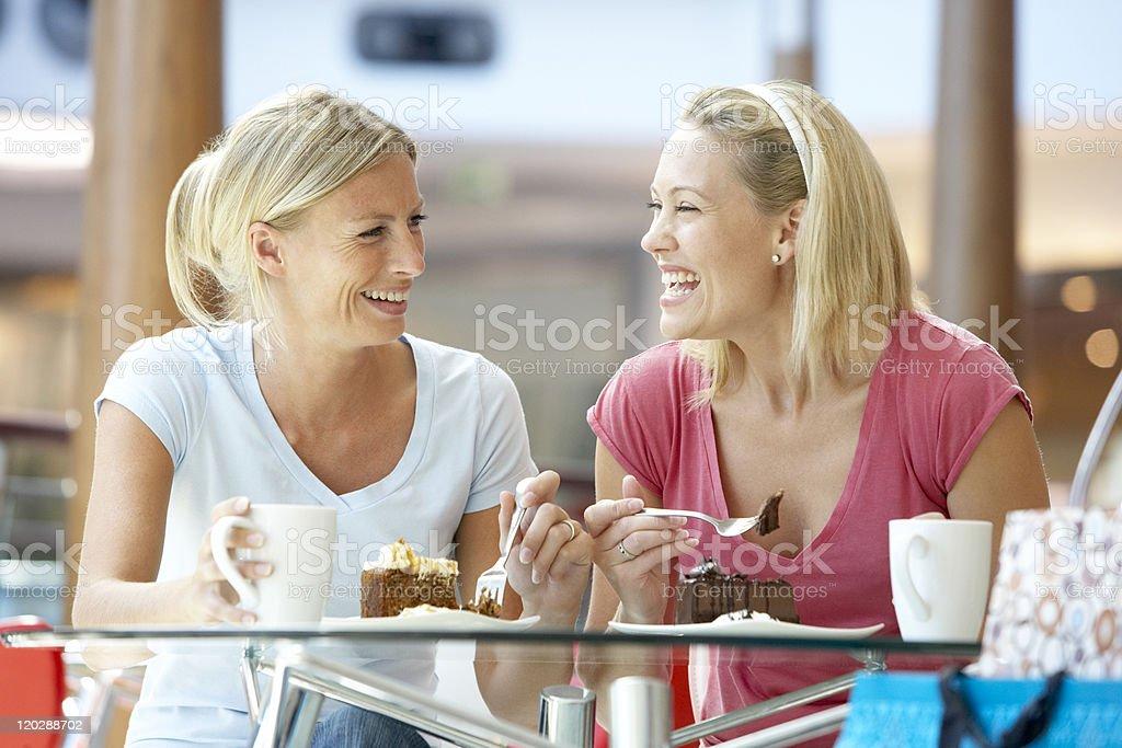 Female friends enjoying their desert together stock photo