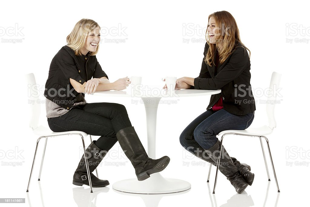 Female friends having coffee in a restaurant royalty-free stock photo