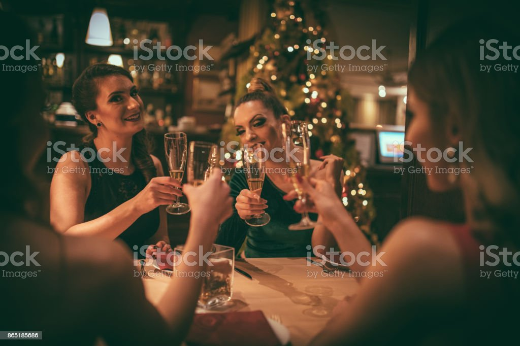 Female friends having dinner party stock photo