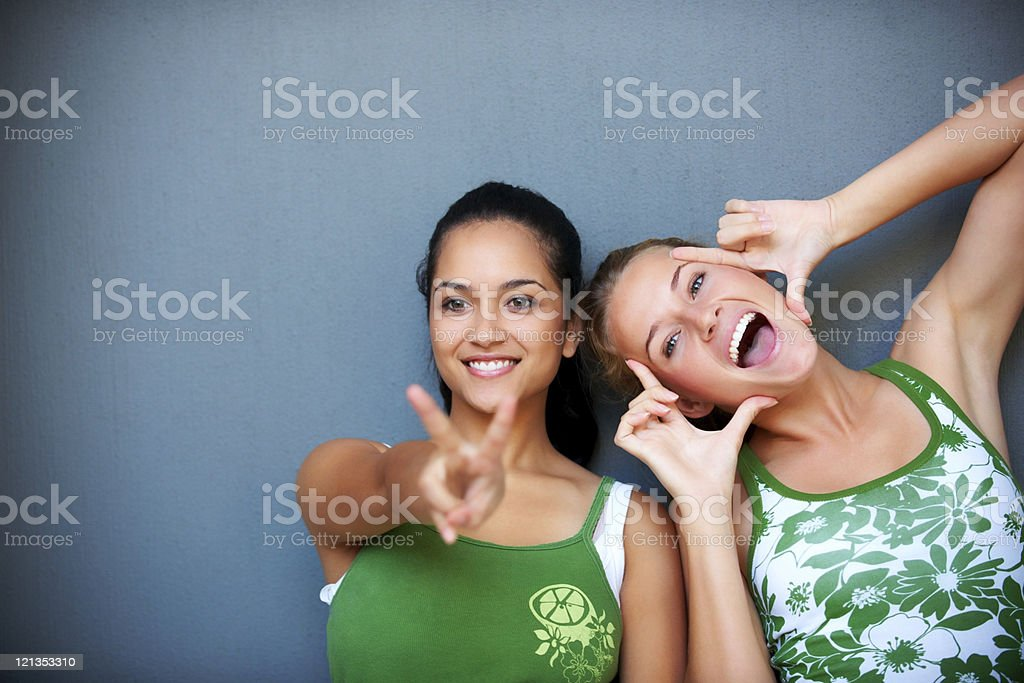Female friends in playful mood making faces royalty-free stock photo