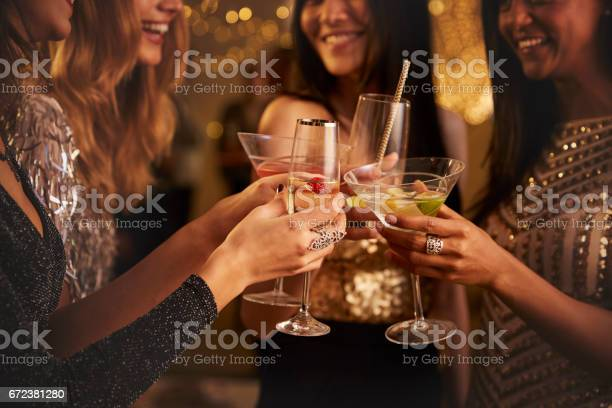 Female friends make toast as they celebrate at party picture id672381280?b=1&k=6&m=672381280&s=612x612&h=ugchab8c5j4p17jguosxmz2d lir9rt9hywfip2e4vo=
