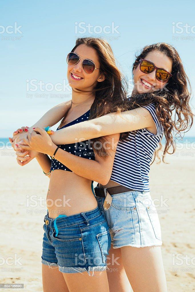 Female friends on the beach stock photo
