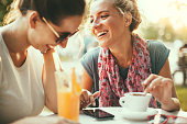 Female friends talking in cafe