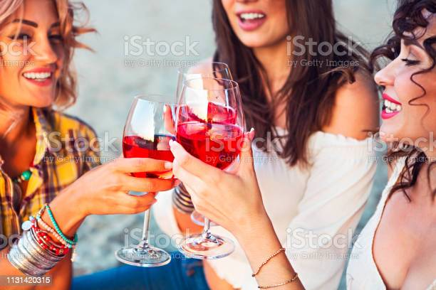 Female friends with glass of rose wine on summer beach picnic picture id1131420315?b=1&k=6&m=1131420315&s=612x612&h=gez2qg9 enas7u7pqr8neemtxftzd0kr5d09uybvtge=