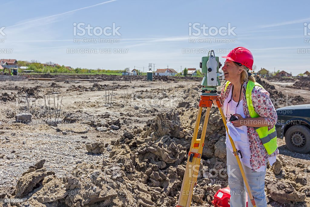 Female geodesist is working with total station. Lizenzfreies stock-foto