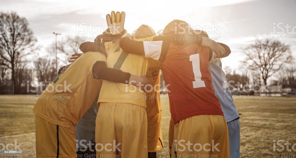 Female Girl Soccer Team celebrating as a group