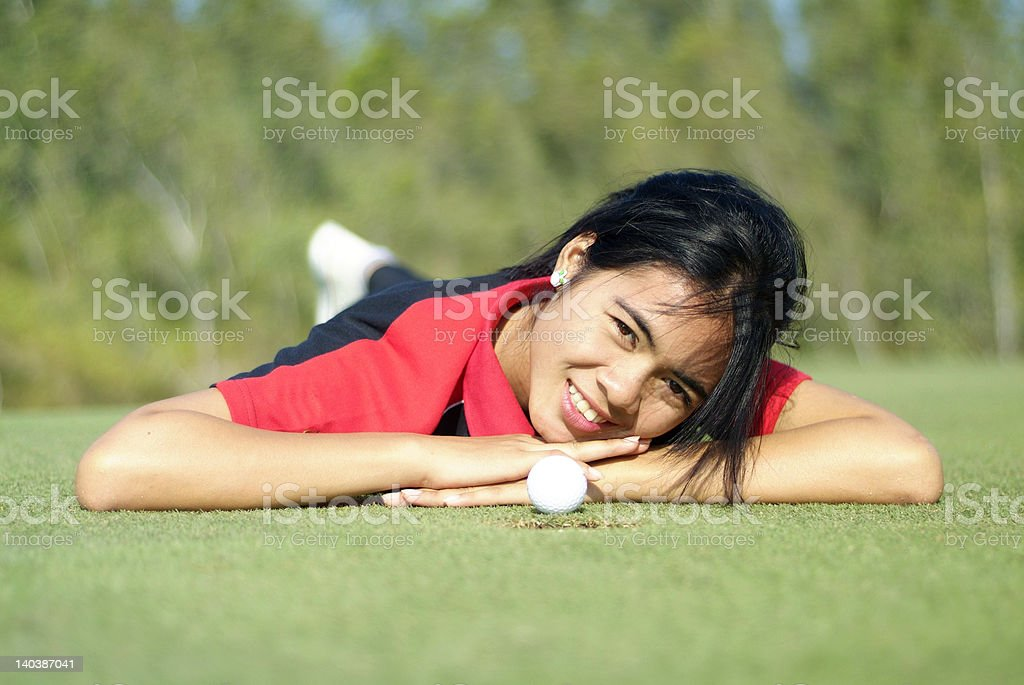 Female golf player on green royalty-free stock photo