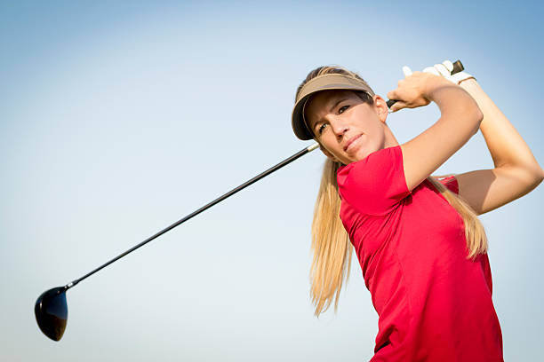 female golfer and her drive - female golfer stock photos and pictures