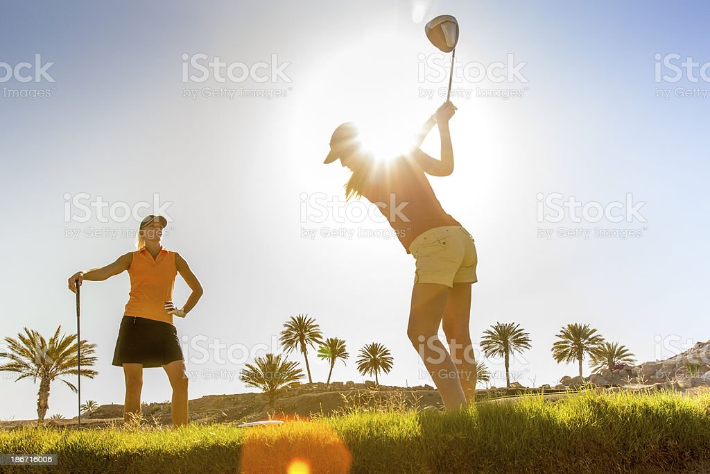 Female Golfer Playing A Shot royalty-free stock photo