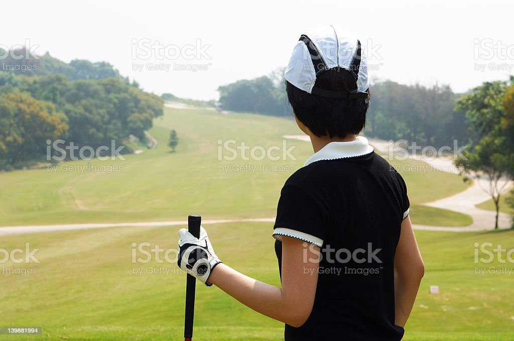 female golfer waiting to play royalty-free stock photo