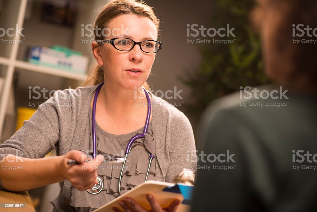female gp advice stock photo