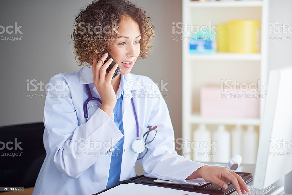 female gp on the phone stock photo