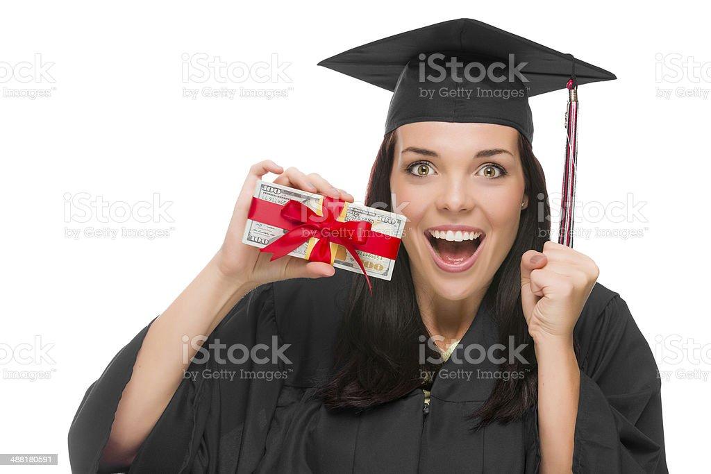 Female Graduate Holding Stack of Gift Wrapped Hundred Dollar Bil stock photo