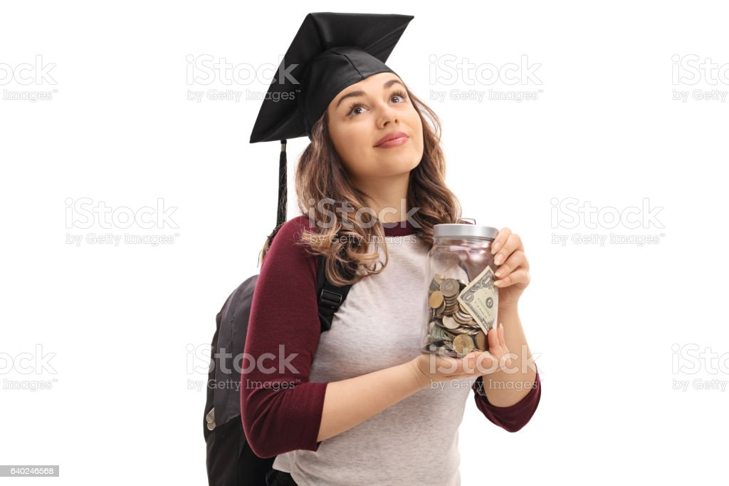 Female graduate student holding a jar filled with money stock photo