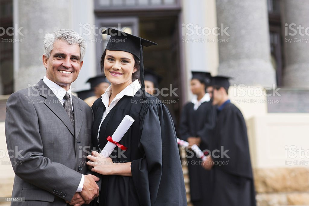female graduate with her father stock photo