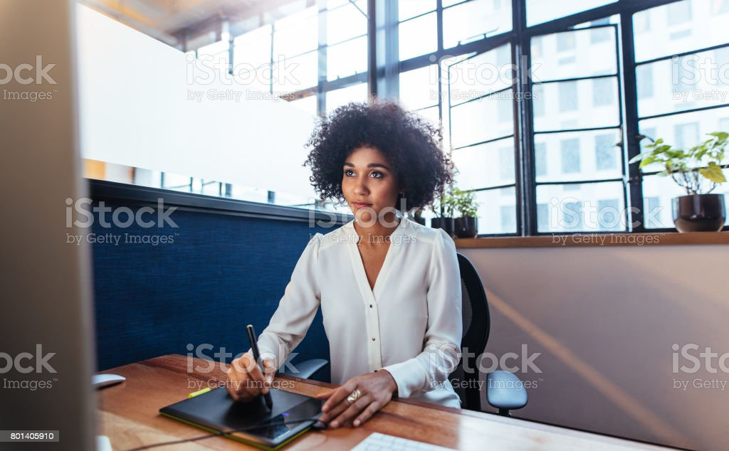Female Graphic Designer Working With Digital Graphic Tablet Stock Photo Download Image Now Istock,Mixed Bag Designs Promo Code