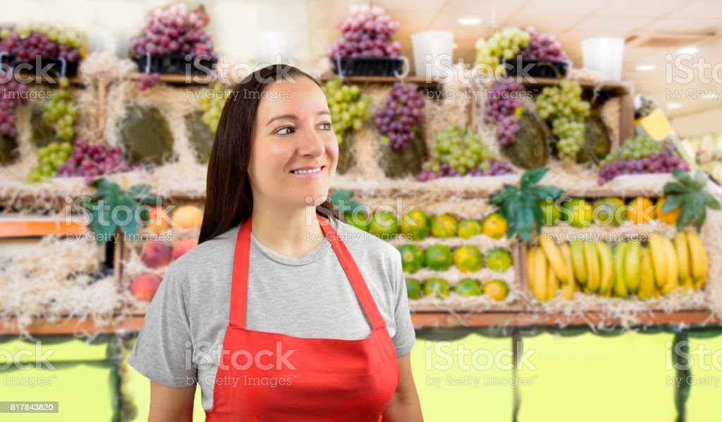 female greengrocer looking askance stock photo