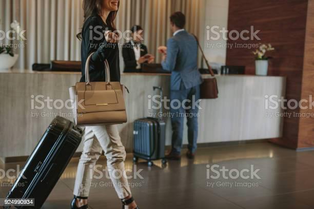 Female guest walks inside a hotel lobby picture id924990934?b=1&k=6&m=924990934&s=612x612&h=u5k3q8t95dqlhq7th2t3g5g3atxc3na3t9cb kp9dqy=