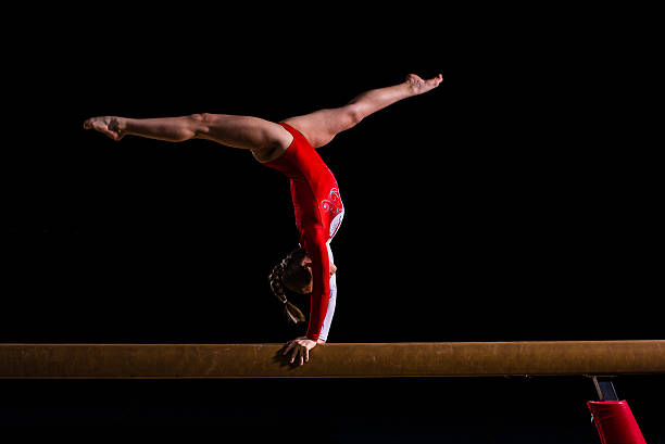 Female gymnast in sports hall stock photo