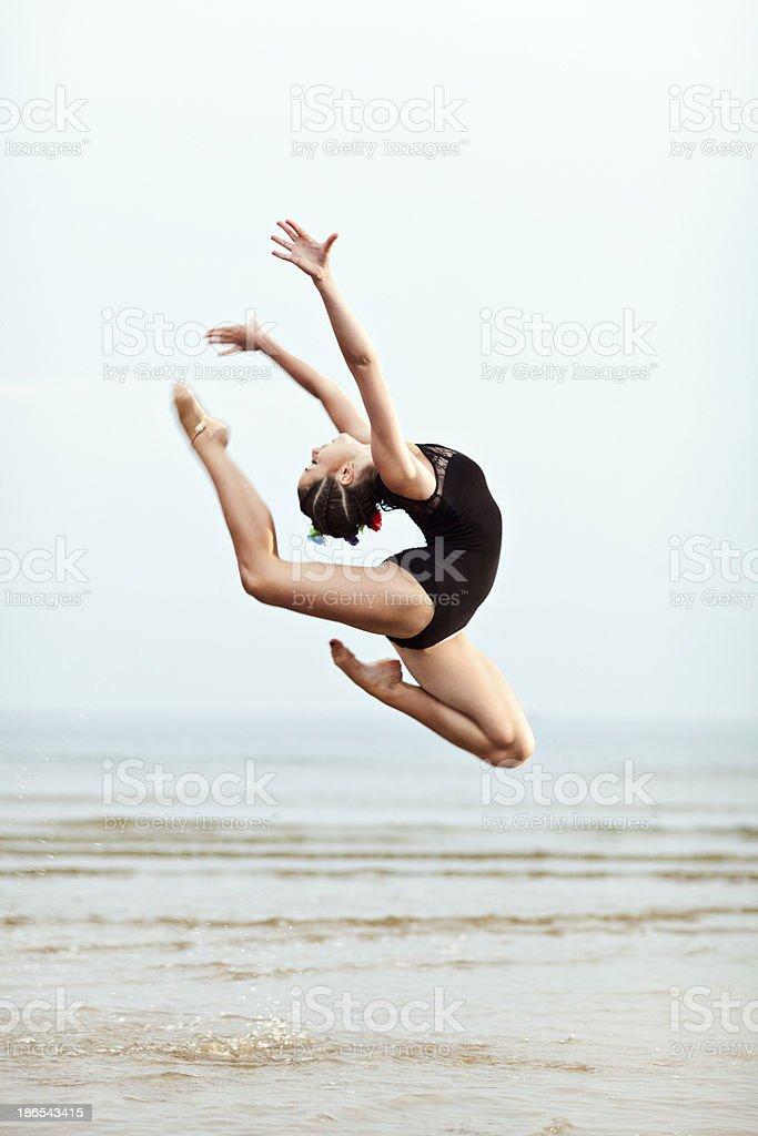 Female Gymnast Jumping stock photo